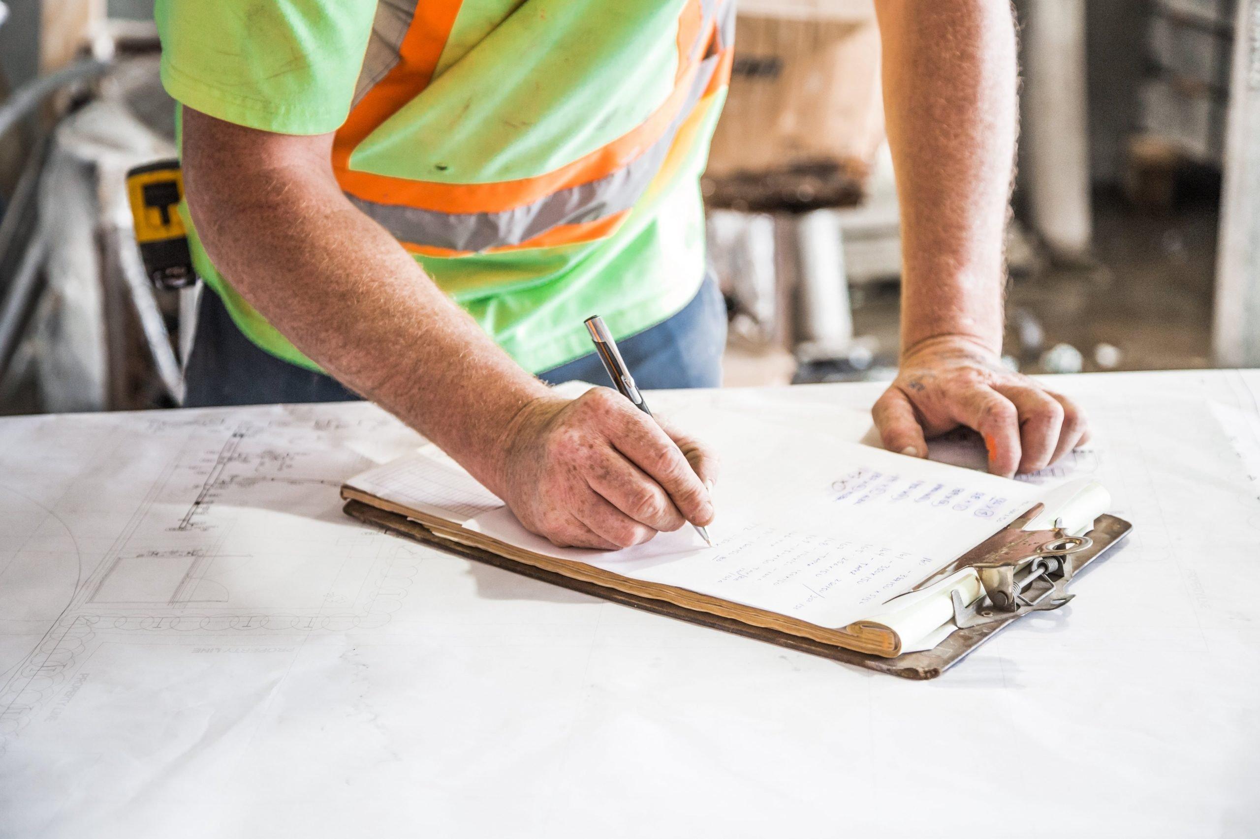 Construction man writing on a pad